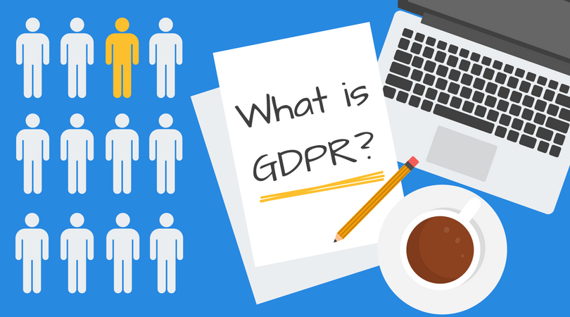 "Table on which are place a coffee mug, laptop, pen and papers on which is written ""What is GDPR"""